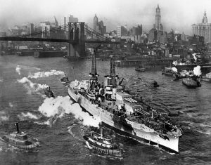 View of USS ARIZONA taken from Manhattan Bridge on the East River in New York City on its way back from sea trials. December 25,1916