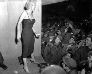 "Marilyn Monroe appearing with the USO Camp Show, ""Anything Goes,"" poses for the shutterbugs after a performance at the 3d U.S. Infantry Division area. Feb. 17, 1954."