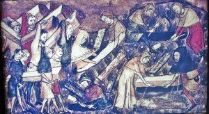 "Exhibit depicting a miniature from a 14th century Belgium manuscript at the Diaspora Museum, Tel Aviv The museum note says ""The citizens of Toumai bury their dead during the black death. Miniature from manuscript, Belgium, 14th century""."
