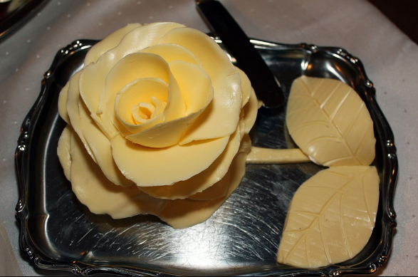 A rose sculpted in butter.