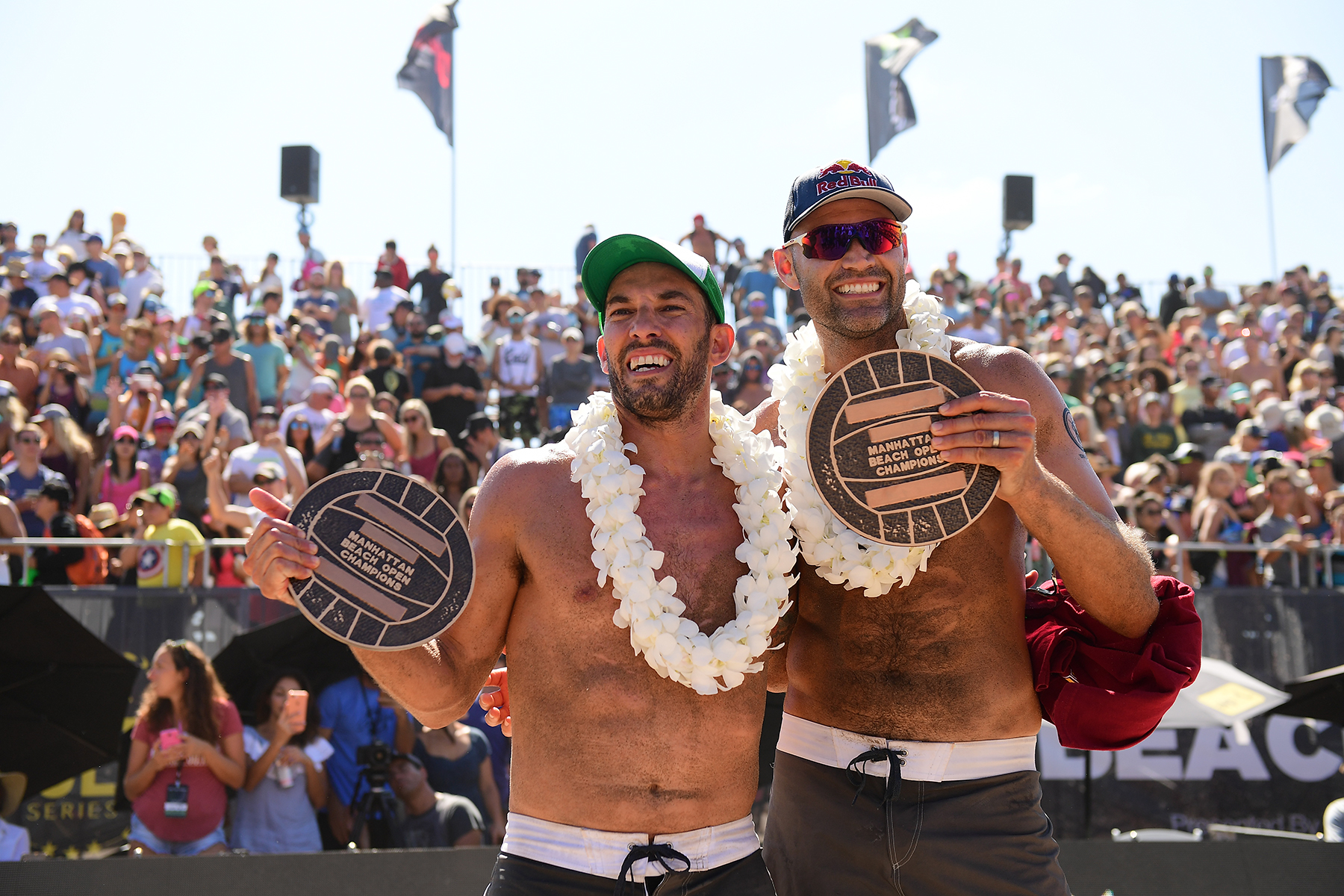 Phil Dalhausser and Nick Lucena hold their winners' plaques at the 2017 AVP Gold Series Manhattan Beach Open Presented by Acer (Photo: Robert Beck)