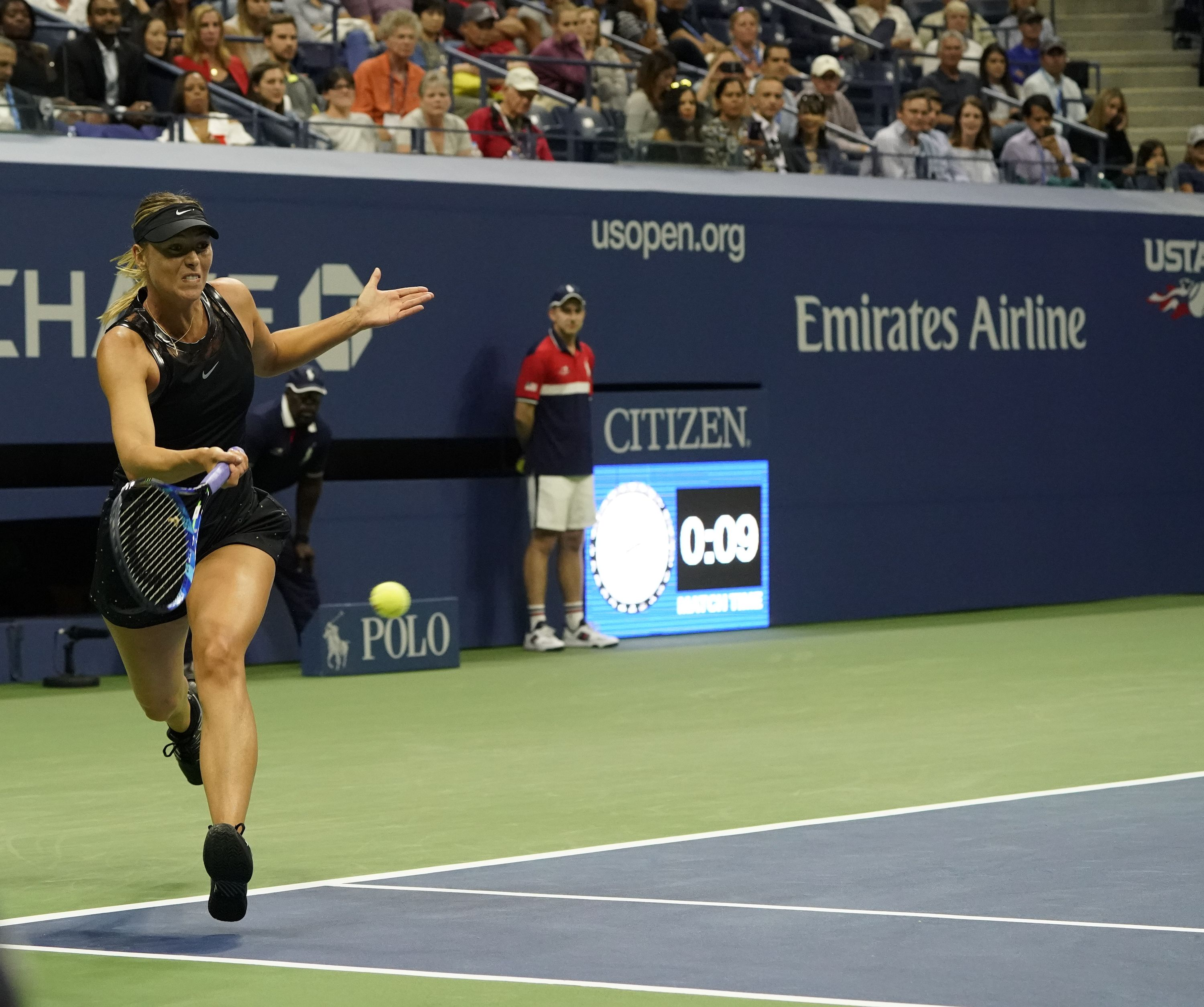 Maria Sharapova returns from the baseline in her U.S. Open match Monday against Simona Halep.(Photo courtesy Lev Radin)