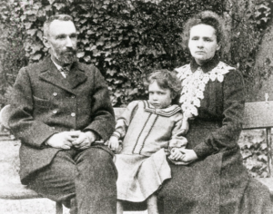 Irene Joliot-Curie as a child with Pierre and Marie Curie