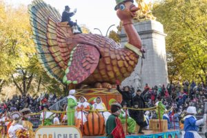 Padma Lakshmi & Tom Colicchio of Top Chef on the Turkey float, 2017 Macy's Thanksgiving Day Parade (Photo: Lev Radin)