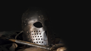 Viking-era helmet and weapon archaeologists