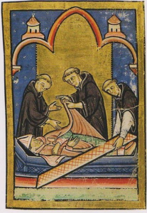12th-century depiction of monks examining an incorrupt St. Cuthbert