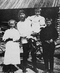 Rasputin w/ his three children (Maria is on the left)