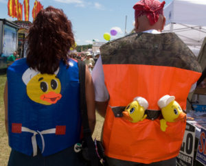 Two revelers on their way to something odd. They're headed for the DuckTape Festival.
