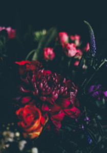 A variety of bold, dark-colored flowers wedding