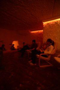 Visitors sit in a salt cave