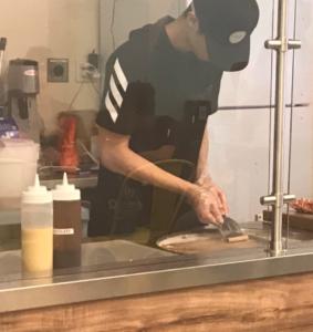 Staff at 22 Below rolls ice cream