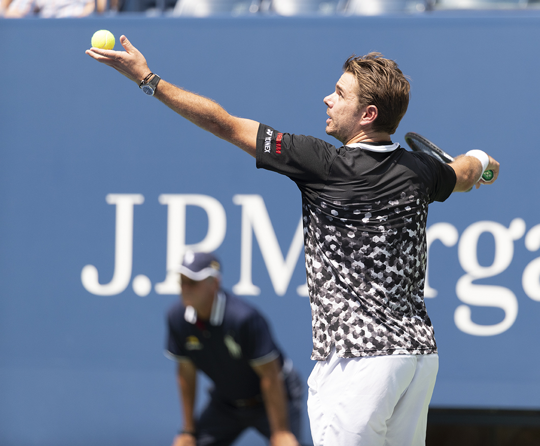 New York, NY - August 27, 2018: Stan Wawrinka of Switzerland serves ball during US Open 2018 1st round match against Grigor Dimitrov of Bulgaria at USTA Billie Jean King National Tennis Center (Photo: Lev Radin/Gildshire)