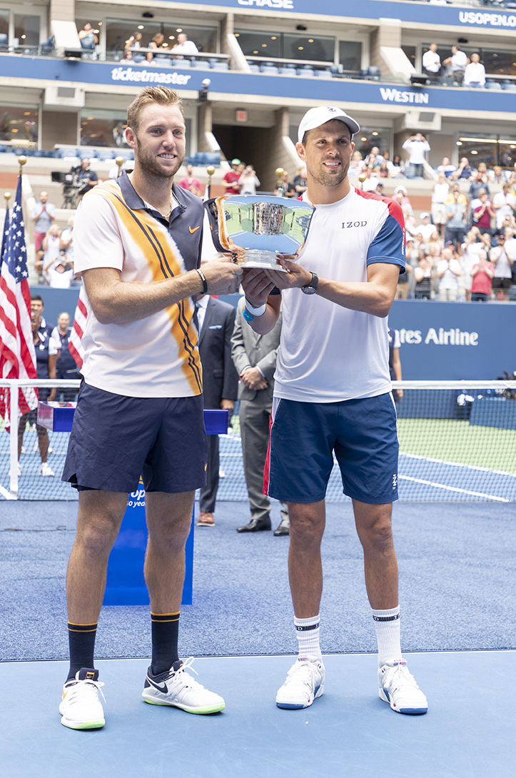 New York, NY - September 7, 2018: Jack Sock and Mike Bryan hold trophy after winning men's doubles final at USTA Billie Jean King National Tennis Center (Photo: Lev Radin/Gildshire)