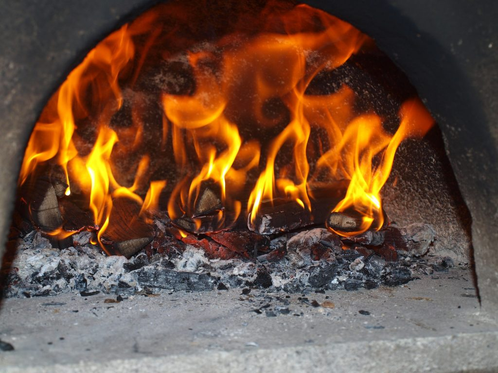 Heat is key. In pizzerias, their ovens get screaming-hot, especially ones that use brick ovens.