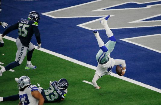 Cowboys' fans flipped over Dak Prescott, shown diving for the end zone against Seattle.