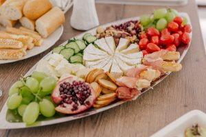 Filling up on healthy appetizers at dinner parties is helpful to not overeat during the main course.